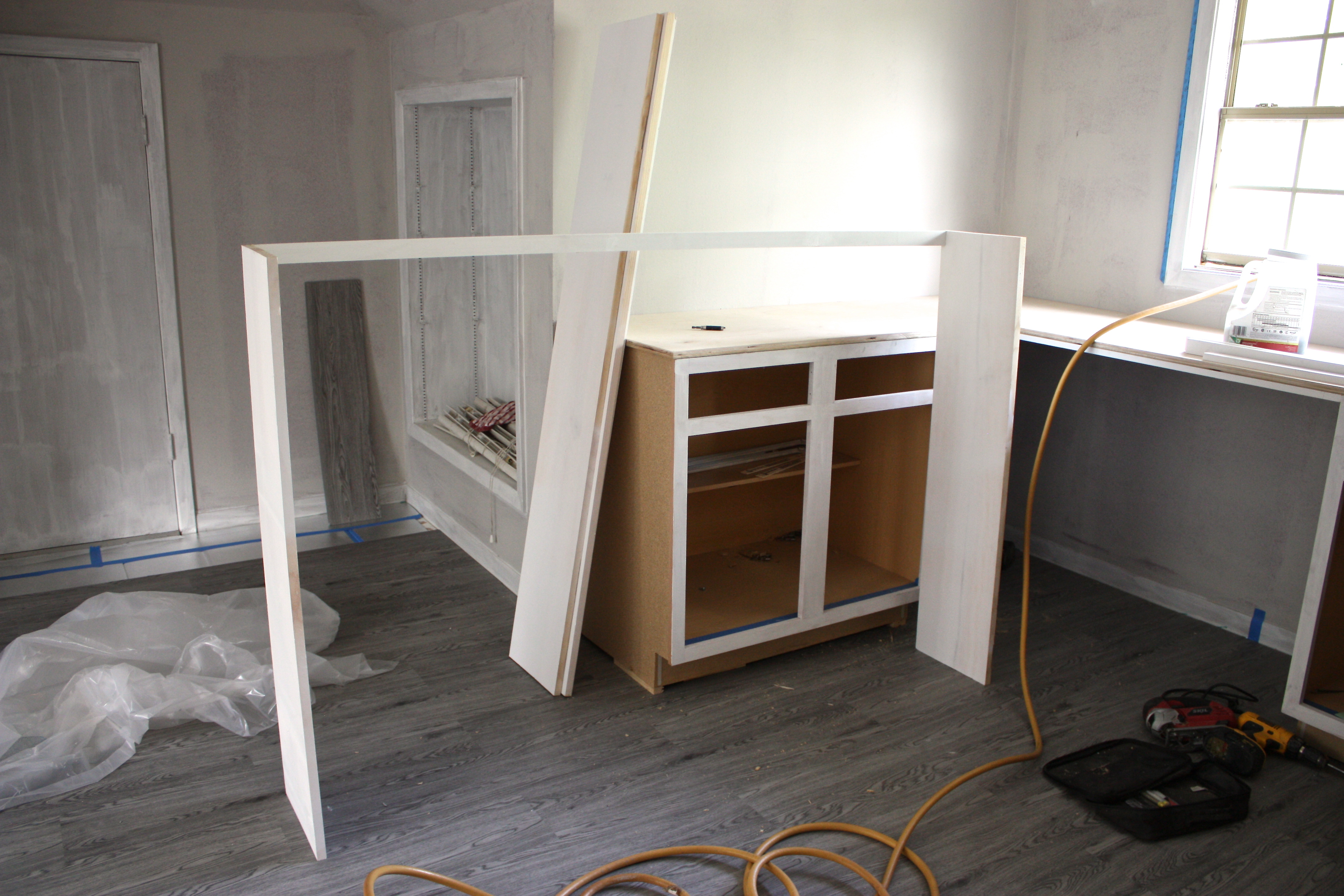 Inexpensive ways to create built in shelving using pre made stock kitchen cabinets The Creativity Exchange