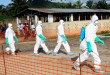 epa04332724 A photograph made available 27 July 2014 shows Liberian health workers in protective gear on the way to bury a woman who died of the Ebola virus from the isolation unit in Foya, Lofa County, Liberia, 02 July 2014. Over 660 people have died of Ebola in West Africa in 2014 making it the world's deadliest outbreak to date. Nigerian authorities have confirmed the death of a Liberian man who was carrying the Ebola virus making it the first case in Nigeria following the outbreak in Guinea, Sierra Leone and Liberia.  EPA/AHMED JALLANZO