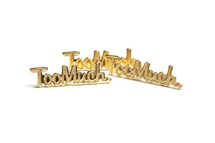 toomuch-gold-pin-badge