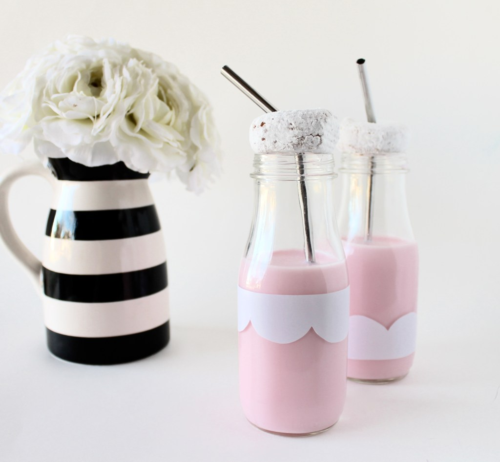 black and white striped vase with white bouquet of flowers aluminum straw powdered donut milk glass with scalloped design