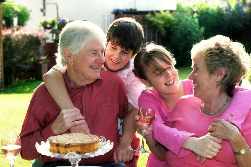 A laughing family celebrating with cake