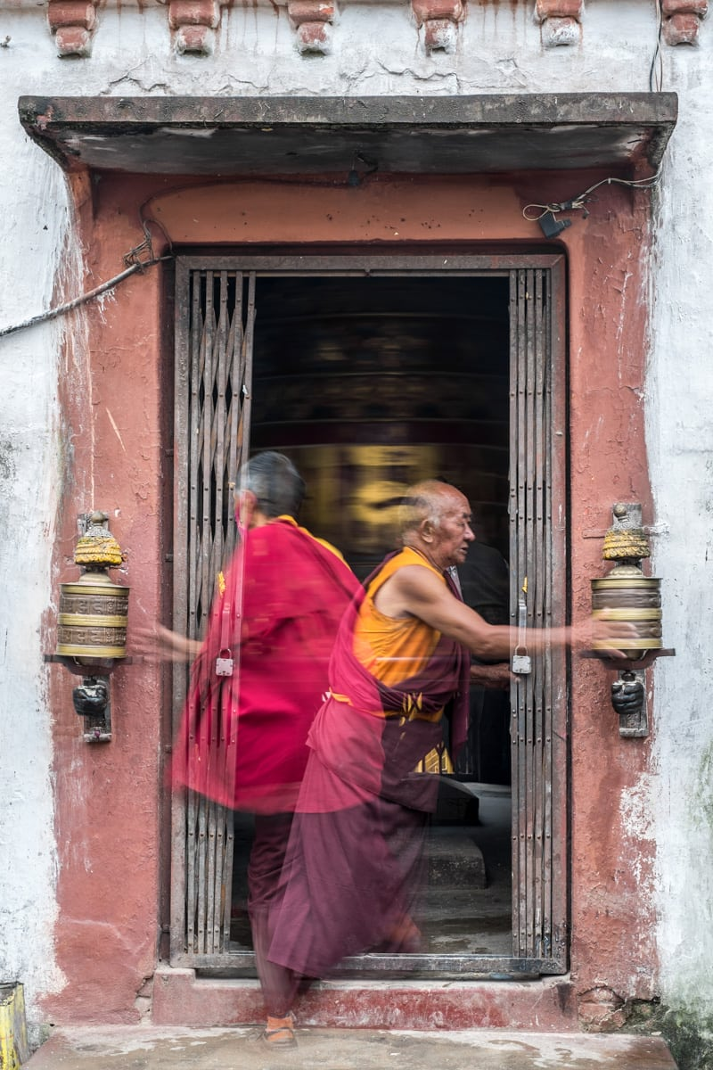 Similar to the image above. I set up a tripod and shot several frames of  people, monks included, coming and going through this doorway.f/5.6, 1/15 sec, at 35mm, 200 ISO, on a X-Pro1