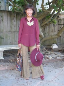 Reliving the nostalgic 70s with bell-bottom lace pants and floppy hat.