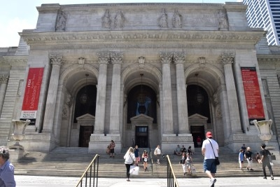 Walking up the steps of the majestic New York Public Library (photo by David).