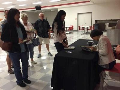 Book signing after the presentation (courtesy of Debi Ecobiza).