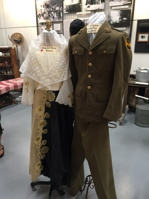 Traditional Maria Clara outfit and a First Filipino Regiment uniform. Note the volcano emblem on the sleeve.