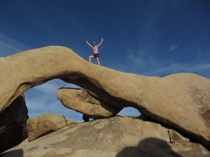 Christine conquering Arch Rock at Joshua Tree National Park