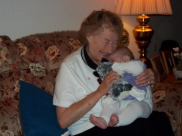 Grandma filled with joy from her great-granddaughter.