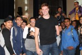 Kevin Laue posing for a picture with Edison students who wanted to have personal conversations with him after motivational speech.  Credit: Nahomi Vindell