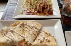 Burrito Loco with BBQ Jackfruit, $17 (top)  Cheese Quesadilla with Seitan Tinga, $10 (bottom)