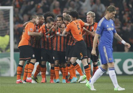 Shakhtar Donetsk players celebrate a goal near Chelsea's Torres during their Champions League Group E soccer match at the Donbass Arena in Donetsk