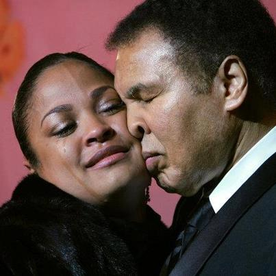 Muhammad Ali Shares a Tender Moment with Daughter.