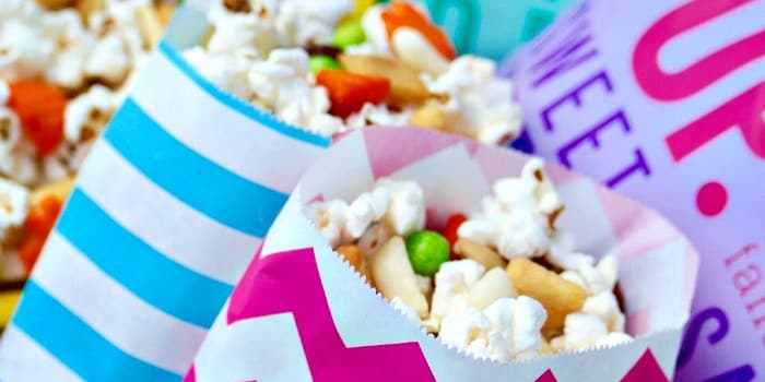 Asian popcorn snack mix to share at a party, family game night or while watching sports! This healthy BOOMCHICKAPOP is made with simple ingredients and will be your favorite low calorie snack! The Foodie Affair