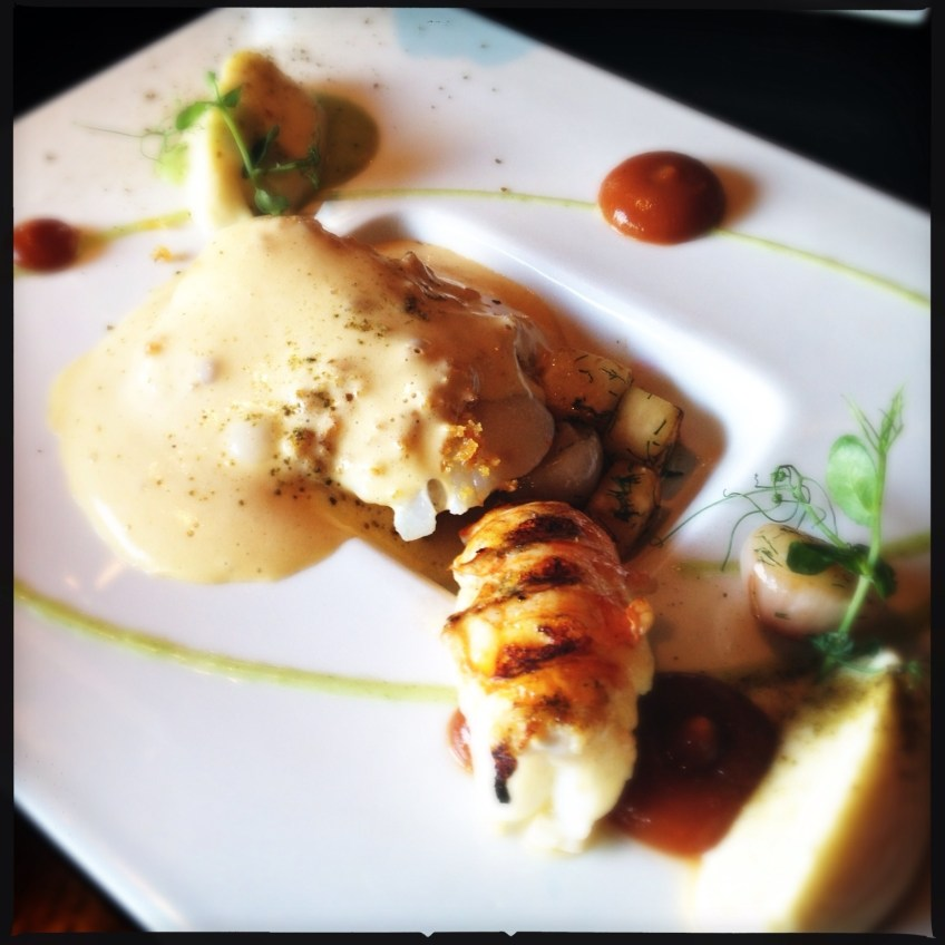 Salted cod with lobster hollandaise and tomato jam garnished with celery root and pearl onions