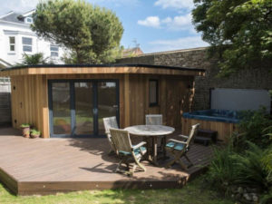 Garden room designed around a hot tub by Harrison James-1