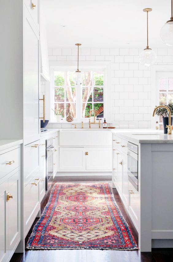 white cabinets, white marble, gold faucet