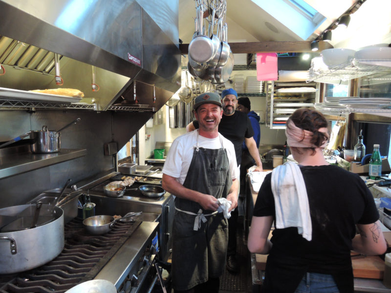 Chef/owner Jason Williams is all smiles in his glorious kitchen preparing the first dinner of the season