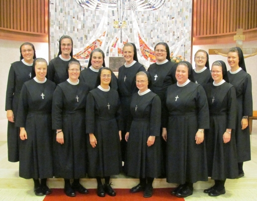 Of the 13 sisters taking final vows with the Sisters of St. Francis of the Martyr St. George in Alton, Ill., Aug. 15 seven are former Benedictine College students.