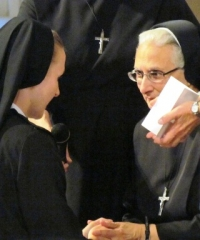 Sister Mary George, Benedictine College class of 2005, makes her vows.