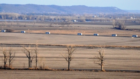 Seven busses cross the Missouri landscape in the dead of winter, headed from Atchison, Kansas, to Washington, D.C.