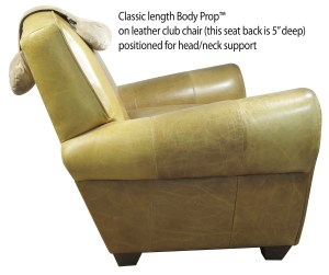 Body Prop Classic on a leather club chair, positioned for head or neck support.