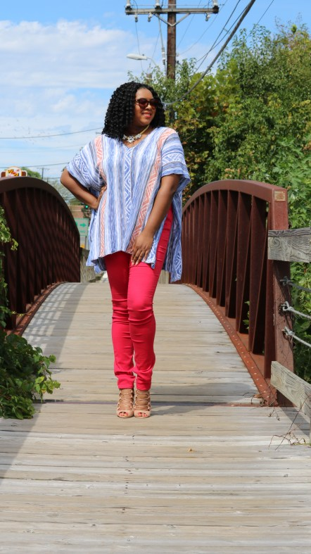 Poncho with red jeans and caged heels