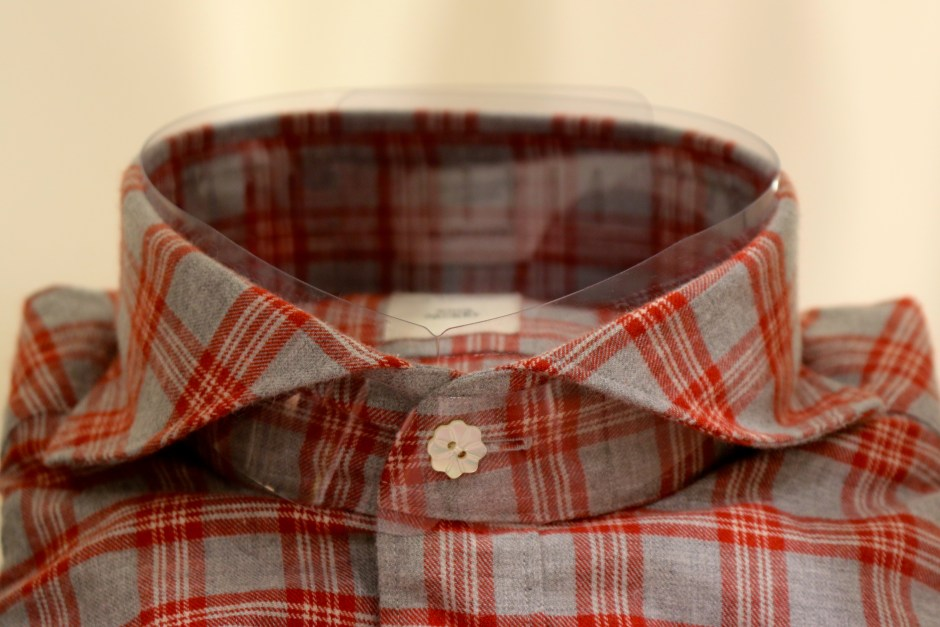 This shirt is a perfect balance of traditional and adventurous: a soft red and grey flannel, but note the button.  Ring Jacket buttons are absolutely beautiful.