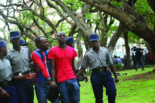 Itai Dzamara and a colleague being led away by police after their arrest in the Africa Unity Square in Harare earlier this year.