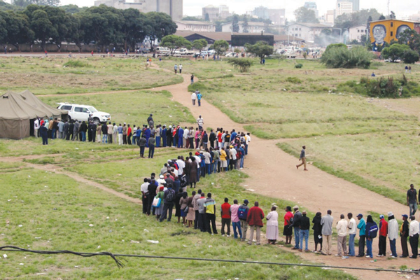 Voters queue to cast their ballots during the last plebiscite.