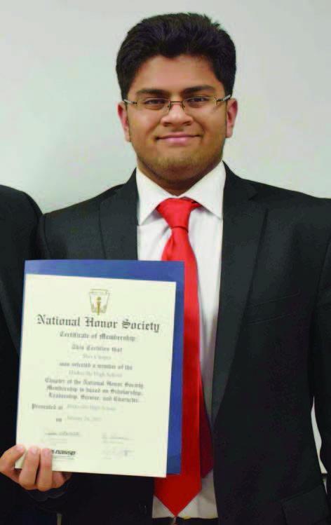 Shiv displaying the membership certificate