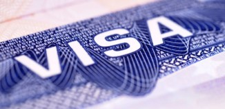 Detail from a US visa document. Selective focus with point of focus in the center of the picture.
