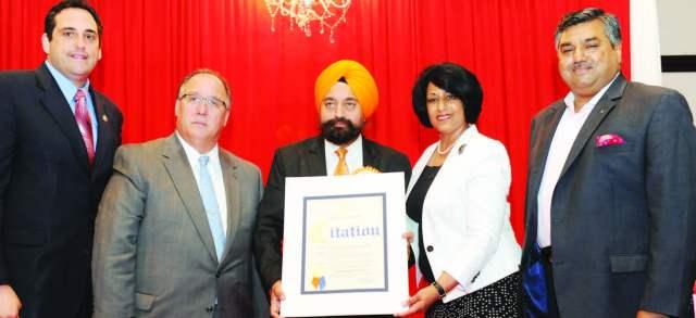 Town of Hempstead Town Clerk Nasrin Ahmad presents a citation to IALI President Satnam Singh Parhar