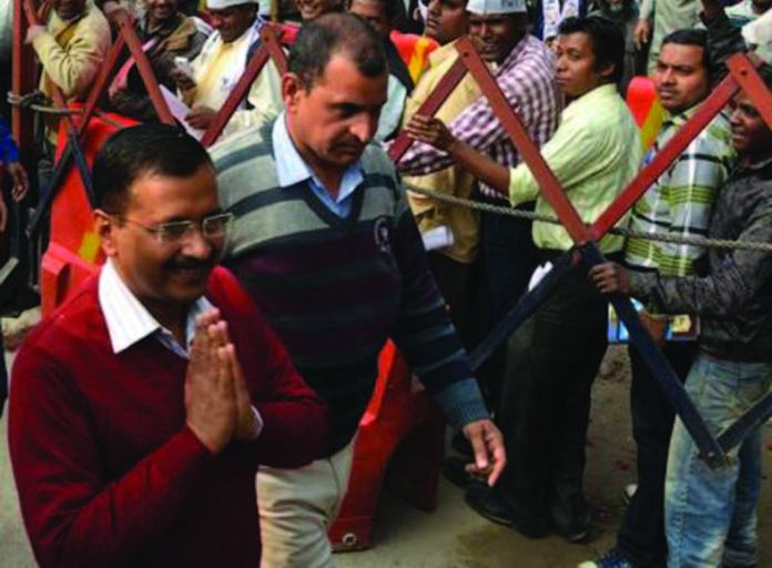 Delhi Chief Minister Arvind Kejriwal arriving to attend the Janta Darbar at the AAP office in Kaushambi in Ghaziabad on Feb 18.