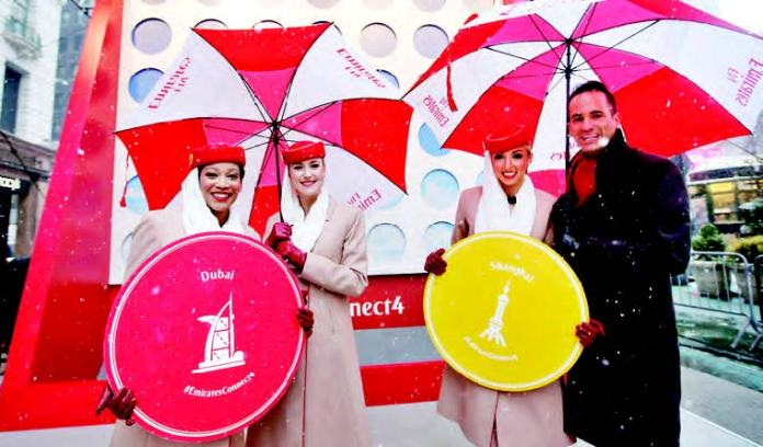 Emirates Cabin Crew mark the celebration of Emirates' fourth daily service from John F. Kennedy International Airport beginning March 8 with a giant Connect 4 Hasbro game in New York's Herald Square, Thursday, March 5, 2015.