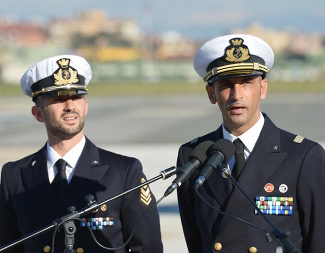 Italian marines Massimiliano Latorre (R) and Salvatore Girone (L) speak to the press at Ciampino airport near Rome, on December 22, 2012. AFP PHOTO/ VINCENZO PINTO