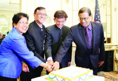 Celebrating India's birthday. India's Consul General Dnyaneshwar M Mulay (second from left) cuts the cake