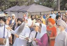 Ecstatic sangat sings Gurbani at the Prabhat Pheri taken out in Gurdwara Glen Cove on September 27