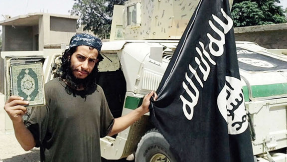 Abdel-hamid Abaaoud holding the Quran & the ISIS Flag