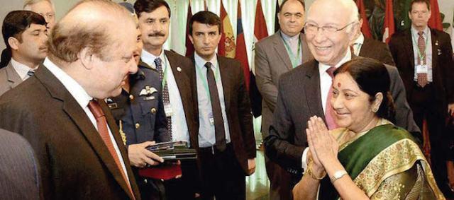 Sushma Swaraj with Nawaz Sharif and Sartaj Aziz in Islamabad on December 9.