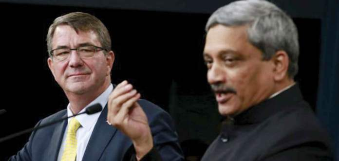 India's Defense Minister Manohar Parrikar (Right) and U.S. Defense Secretary Ash Carter hold a joint press conference after their meeting at the Pentagon in Washington, December 10, 2015.