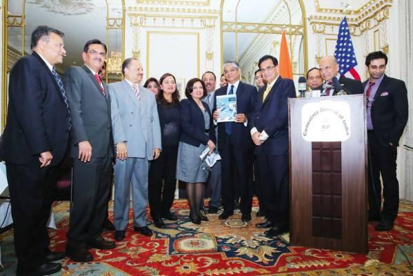 Ambassador Arun Singh releasing AAPI's 34th annual Convention Souvenir