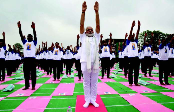 Prime Minister Narendra Modi participating in the mass yoga demonstration at the Capitol Complex, Chandigarh, on the occasion of the 2nd International Day of Yoga on June 21.
