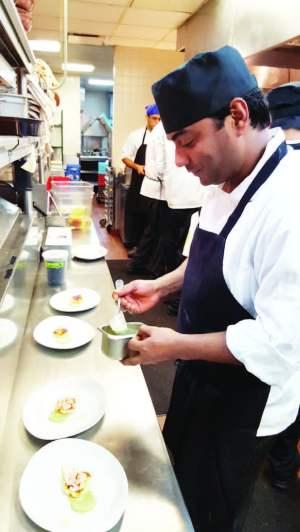 Chef Dheeraj Tomar giving a touch of his culinary expertiseat the famous Junoon