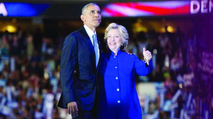 US President Barack Obama hugs Democratic presidential nominee Hillary Clinton on Day 3 of the ongoing convention in Philadelphia, Pennsylvania. #DNCinPHIL,