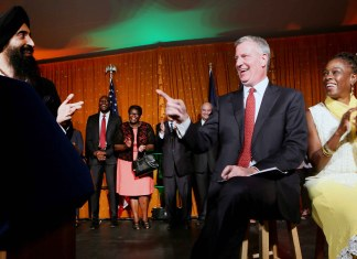 New York City Mayor Bill de Blasio and his wife Chirlane McCray (right), enjoy a lighter moment as Waris Ahluwalia (right), Actor, Designer, Model speaks on the occasion Photo/ Jay Mandal/On Assignment