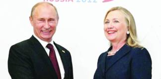 Vladimir Putin (left) and Hillary Clinton