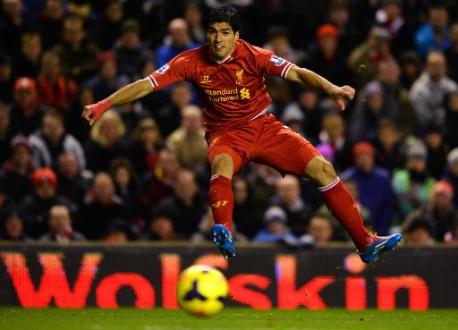 Four-star Suarez leads Liverpool rout of Norwich