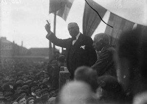 IPP leader John Redmond tells a meeting on Home Rule in 1912 to listen the History Show!