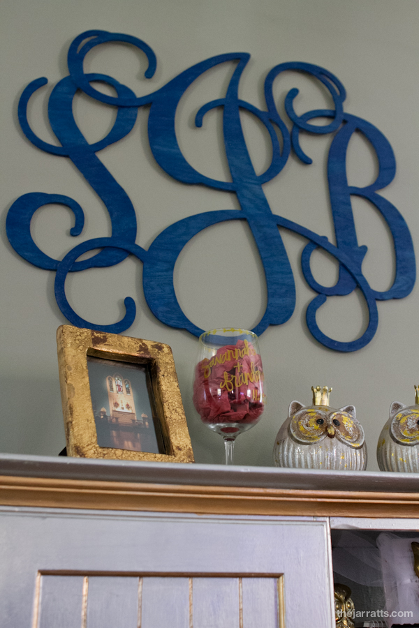Letters above, gold frame and photo from the Mark Jarratts and souvenir wine glass hand painted by Hadley for savannah's bachelorette party