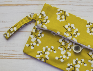 sewing machine | yellow fold-over clutch